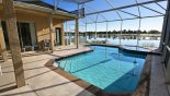 View of pool & spa with amazing lake views with this Orlando Villa for rent direct from owner