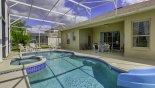Orlando Villa for rent direct from owner, check out the View of pool towards covered shady lanai with patio table & 4 chairs