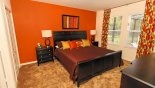 Master suite with king sized bed and views onto pool deck with this Orlando Villa for rent direct from owner