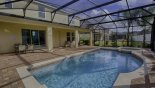 Spacious rental The Shire at West Haven Villa in Orlando complete with stunning View of covered lanai from pool deck