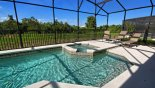 Sunny pool deck with attractive conservation views - www.iwantavilla.com is the best in Orlando vacation Villa rentals