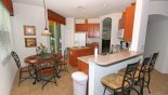 Kitchen with breakfast nook - also breakfast bar and 3 bar stools with this Orlando Villa for rent direct from owner