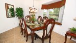 Dining table with 6 chairs and attractive bay window with views to side aspect from Ocean Palm 2 Villa for rent in Orlando