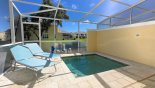 View of pool deck and plunge pool with 2 sun loungers with this Orlando Townhouse for rent direct from owner