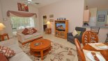 Villa rentals in Orlando, check out the Family room with direct access onto pool deck