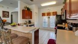 View of kitchen & breakfast bar - www.iwantavilla.com is the best in Orlando vacation Villa rentals