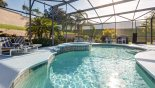 Pool deck showing toddler pool safety fence folded up to the side from Evergreen 1 Villa for rent in Orlando