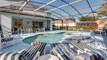 Private pool deck with ample pool furniture with this Orlando Villa for rent direct from owner