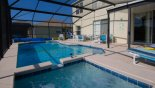 Pool deck with 4 sun loungers and shady lanai from Longboat Key 1 Villa for rent in Orlando