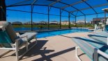 View of pool deck with 4 sun loungers - www.iwantavilla.com is the best in Orlando vacation Villa rentals