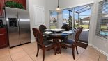 Breakfast nook with direct access onto pool deck from Windsor Hills Resort rental Villa direct from owner