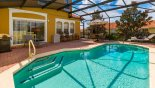 Sunny pool deck with 2 sun loungers, 2 reclining chairs & patio table with 6 chairs from Encantada rental Townhouse direct from owner
