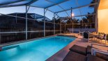 Spacious rental Indian Point Villa in Orlando complete with stunning The pool and deck at twilight showing underwater lighting