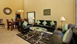 Villa rentals near Disney direct with owner, check out the Living room with leather sofas & arm chair