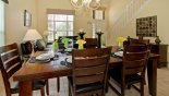Spacious rental Oak Island Villa in Orlando complete with stunning Dining table with 6/8 chairs