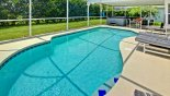 Spacious rental Oak Island Villa in Orlando complete with stunning Fencing and hedges provide maximum privacy