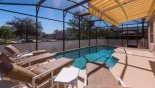 Spacious rental Windsor Palms Villa in Orlando complete with stunning Large sunny pool deck with retractable awning for additional shade.