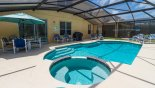 View of pool and spa showing all 6 sun loungers - www.iwantavilla.com is the best in Orlando vacation Villa rentals