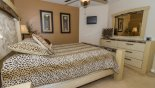 Bedroom 5 with wall mounted LCD TV with this Orlando Villa for rent direct from owner