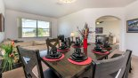 Dining area with seating for 6 on chairs plus additional seating for 3 on padded bench from Highlands Reserve rental Villa direct from owner