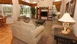 Family room with views onto pool deck - www.iwantavilla.com is the best in Orlando vacation Villa rentals