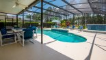 Spacious rental Highlands Reserve Villa in Orlando complete with stunning Covered lanai with ceiling fan offers welcome shade - perfect for alfresco dining