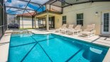 Shady lanai with patio table & 6 chairs from Roccella 1 Villa for rent in Orlando