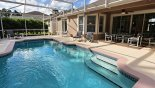 View of pool towards covered lanai with patio table & 6 chairs from Emerald + 9 Villa for rent in Orlando