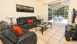 Family room with omfortable leather seating and direct views & access onto pool deck from Monticello 11 Villa for rent in Orlando