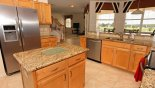 View of luxury kitchen towards family room with this Orlando Villa for rent direct from owner