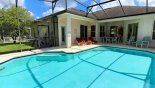 Covered lanai with patio table & 6 chairs from Highlands Reserve rental Villa direct from owner