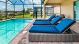 Spacious rental Windsor at Westside Villa in Orlando complete with stunning Pool deck with 3 quality sun loungers & patio table with 8 chairs