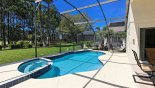 Sunny pool deck with views onto golf course from Newton 3 Villa for rent in Orlando