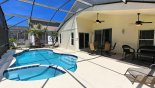 View of pool & spa viewed towards shady covered lanai - www.iwantavilla.com is your first choice of Villa rentals in Orlando direct with owner