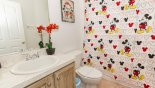 Family bathroom 2 with Mickey theming - www.iwantavilla.com is the best in Orlando vacation Villa rentals