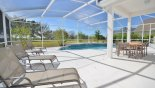 Pool deck with 4 sun loungers from Birchwood 2 Villa for rent in Orlando