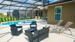 Villa rentals in Orlando, check out the Pool deck with 4 sun loungers, patio table & 4 chairs and rattan pool furniture