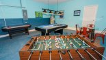 Games room with pool table, air hockey & table foosball - www.iwantavilla.com is your first choice of Villa rentals in Orlando direct with owner
