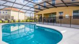Pool deck with 4 sun loungers & pool safety fence installed - www.iwantavilla.com is your first choice of Villa rentals in Orlando direct with owner