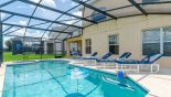 Spacious rental Emerald Island Resort Villa in Orlando complete with stunning Pool deck with 4 sun loungers