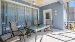 Covered lanai with patio table & 6 chairs from Emerald + 10 Villa for rent in Orlando
