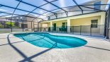 Queen Palm 8 Villa rental near Disney with Pool showing pool safety fence erected - 4 sun loungers provided