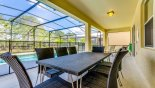 Villa rentals in Orlando, check out the Shady lanai with patio table & 8 chairs - great for alfresco dining