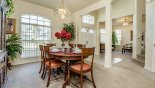 View of dining area toward entrance foyer - www.iwantavilla.com is the best in Orlando vacation Villa rentals