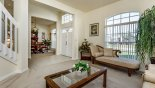 Spacious rental Highlands Reserve Villa in Orlando complete with stunning View of living room towards entrance foyer