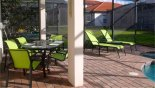 Covered lanai with patio table & 6 chairs from Valencia 1 Villa for rent in Orlando