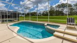 Sunny pool deck with large pool, spa & golf course views - www.iwantavilla.com is your first choice of Villa rentals in Orlando direct with owner