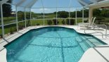 Villa rentals in Orlando, check out the View of pool and canal beyond
