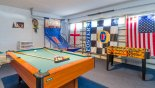 Games room with pool table, table foosball & basketball game from Magnolia Tree 1 Villa for rent in Orlando