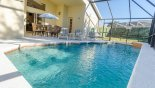 View of pool towards covered lanai from Orange Tree rental Villa direct from owner